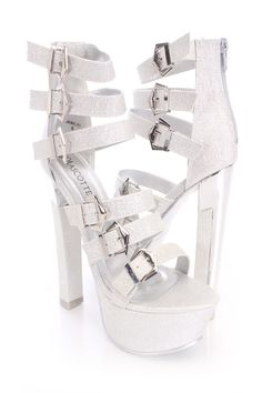 The features include a glitter upper in a strappy design with high polish buckle accents, open toe, mirrored capped chunky heel, back zipper closure, smooth lining, and cushioned footbed. Approximately 6 inch heels and 2 inch platforms.