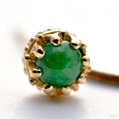 Yellow-gold crown bezel nostril screw with jade cabochon, from BVLA.