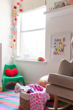 Green IKEA BUNSO kids' chair and Bright Lab lights in modern nursery