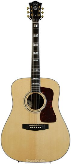 Guild D-55.  This is Guild's top of the range acoustic guitar with a Solid AAA Spruce top and Solid Rosewood Sides with a Solid Bookmatched Rosewood  Back. For a guide to The Best Acoustic Guitar Brands see http://www.guitarsite.com/best-acoustic-guitar/