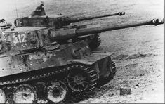 Two tigers from Panzer-Abteilung 505 with numerous hits received from anti-tank guns in the fighting at the Kursk Bulge