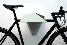Sculptural Bike Storage  Quarterre designed three sculptural bike storage solutions –- Hood, Branchline, and Shadow –- to support everyday life on two wheels. The pieces are not only useful and good-looking, they elevate the bike to a work of art.