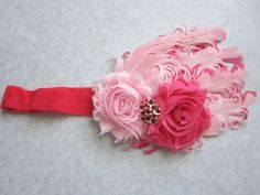Light & Dark Pink Curled Nagorie Feather Headband. $14.00, via Etsy. bow sequin photo shoot baby girl rhinestone birthday newborn lace satin bow curled feather pad pink white light pink dark pink rose coral red chiffon rosette