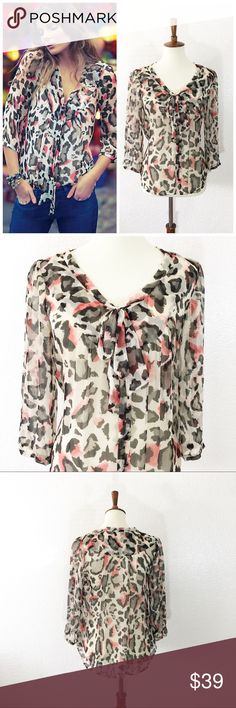 """Anthropologie Maeve leopard print blouse Details: beautiful sheer leopard print. Ties in the front and buttons down.  Size: 6 Material: in photos  Condition: EUC Measurements are taken flat! Chest:  19"""" armpit to armpit)  Length:  26"""" from shoulder)  ☑️ Bundle Discounts  ☑️Fast shipping  ☑️Posh Ambassador  ✨Shop with Confidence Anthropologie Tops Blouses"""