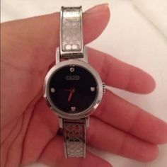 Coach watch Authentic Coach watch. Bought in Coach store. Inside has 4 little diamonds. Face has a couple minor scratches, but overall great condition. Accessories Watches