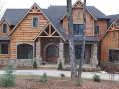 LOVE the siding and the combination of rock siding with the woord!