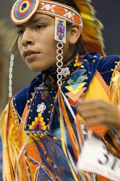 Description: Powwows are large social gatherings of Native Americans who follow traditional dances started centuries ago by their ancestors, and which continually evolve to include contemporary aspects. These events of drum music, dancing, singing, a