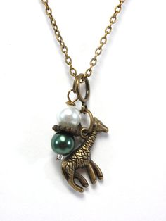 Giraffe Charm Necklace  Antique Gold and by GalvestonTradingCo, $23.00