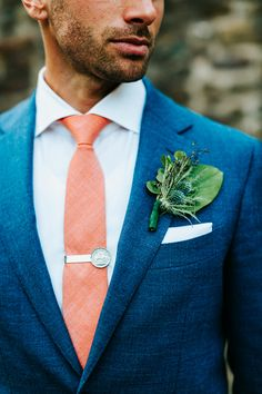 thistle boutonniere - photo by danfredo photos and films http://ruffledblog.com/heartfelt-pennsylvania-wedding/