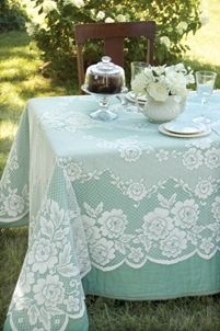 Lace table cloth over an aqua table cloth - LOVE IT