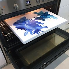 Melt the crayon onto canvas in the oven