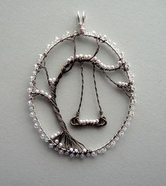 Louise Goodchild | The First Snow pendant | tree of life with swing, seed beads as snow | Flickr (photo only)