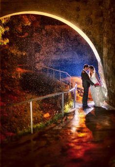 Bride and groom under a heavy rain at the end of their wedding day Wedding Day, Rain, Wedding Photography, Bride, Concert, Inspiration, Wedding Couple Photos, Pi Day Wedding, Rain Fall