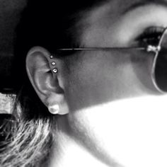 ear piercing. triple forward helix.