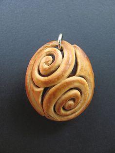 Pit Carved Spiral Pendant