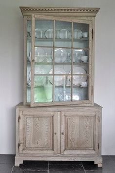 convert stock cabinet/book case to armoire and use Driftwood Weathered Wood Finish to achieve this silvery driftwood look.  Available at DIYDriftwood.com
