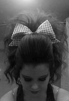 teased pony with poof cheer hair...That's what my team did last year for our last competition last season!