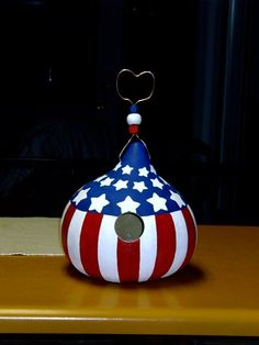 Red, white and blue bird house gourd with hand painted beading.