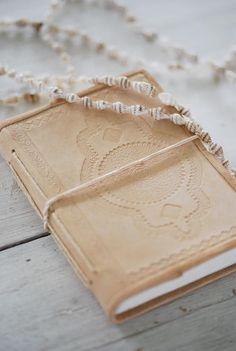 embossed leather cover, handmade paper notebook. http://shop.biskopsgarden.com
