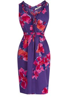 This floral print sundress has a fitted waist and frill detailing to the neckline.