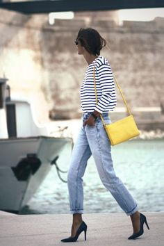 stiped tee, high-waist jeans, pumps, bright purse