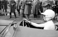 Mrs.Jean Bloxam, leaving the pits in her Aston Martin, to take part in the supporting sports car race at the Aintree 200 meeting , finishing 8th out of 19 entrants  ..  Saturday 18th.April 1959