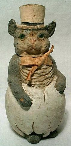 Superb antique paper mache figural candy container - easter cat in an egg.