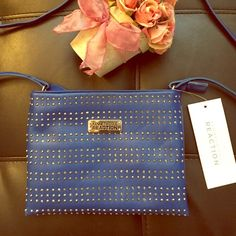 NWT KENNETHCOLE REACTION Summer blu leather & gems Beautiful eye catching blue leather purse by KENNETHCOLE ! I love this purse so much just got news military's relocating my family so I have to make $! Shoulder strap purse can be shorter or longer! Very EYECATCHING when the sun hits the purse there's 100's of sparkly gems all over the front inside still has the new paper stuffing the purse and there is one zip up pocket! Perfect purse for summer time beautiful summer Bright Royal Blue! Or…