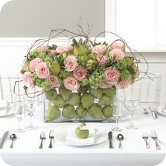 green hydrangea, pink roses, curly willow, and pears in a low rectangle--w/ matching pear place cards