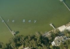 500 Navy Cove Blvd, Gulf Breeze, FL 32561 - Zillow  This is the property we did not purchase 27 years ago when we moved here.
