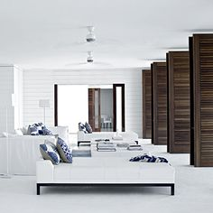 Set the Scene    No need for decorations in this room. The modern furniture in this sleek living room all faces the floor-to-ceiling louvered wood doors, which provide maximum cross-ventilation not to mention an incredible view.