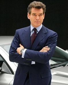 PIERCE BROSNAN - Anthony Jones/UK Press/Getty - wears a suit impeccably and tailored correctly. He always looks great. Pierce Brosnan, Style James Bond, Percy Jackson Serie, Anthony Jones, Hommes Sexy, Handsome Actors, Best Mens Fashion, Gentleman Style, Dapper Gentleman