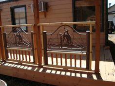 Our rustic porch, The Metal Work Rails - A friend had these twin sized headboards and footboards they did not want anymore.  They are cast iron with bucking horses on them.  We live in a Rodeo Town so we got the idea to use these headboards and footboards in the railing of our new porch.  We tried to find more for all the rails and could not, so we started a star theme.  We get a lot of compliments, people can't believe they were actually bed frames.., Front side of deck/porch - work in…