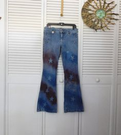 Upcycled painted red white and blue striped star hip hugger, flair bell bottom jeans.  There are not tags on the jeans for size except one that
