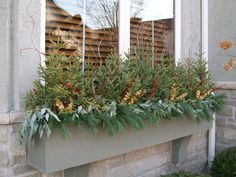 Flower boxes for winter?  Absolutely!  Spruce tips, pine boughs, seeded eucalyptus, curly willow and a little sparkle are perfect in a window box all season!