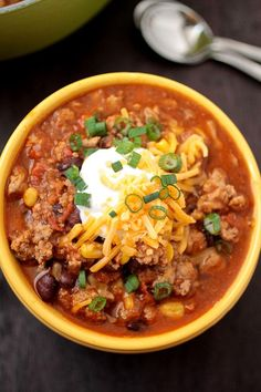 Turkey, Corn, & Black Bean Chili garnished with a scoop of Plain Greek Yogurt