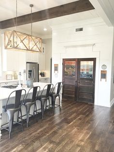 Kitchen, old barn doors, shiplap, modern farmhouse, light fixture Beverage Building & Remodeling https://www.facebook.com/beveragebuilding/
