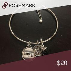 Handmade happy bracelet 7.5 inch but adjustable, happy charm, black sparkle charm, and a design charm. designsbyci Jewelry Bracelets