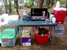 Tent camping kitchen setup- a water cooler sounds like a good investment.