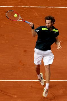 Ernests Gulbis Photos - Ernests Gulbis of Latvia returns a shot during his men's singles quarter-final match against Tomas Berdych of Czech Republic on day ten of the French Open at Roland Garros on June 2014 in Paris, France. French Open, Tennis, Running, Day, Sports, Photos, Sneakers, Racing, Hs Sports