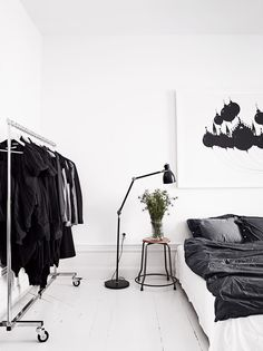 Nordic. Love the big graphic print above the bed. Great contrasts