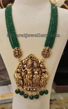 Multiple strings emerald beads long chain with detachable nakshi work Lord Radha Krishna Pendant. Dual peacock embellished at the two sides of the krishna Gold Jewellery Design, Bead Jewellery, Temple Jewellery, Beaded Jewelry, Jewelry Necklaces, Emerald Jewelry, Gold Jewelry, Gold Necklace, Necklace Set
