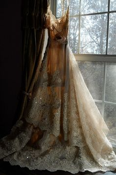 Soft and romantic antique silk and lace wedding dress