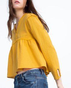 Imagem 1 de BLUSA DECOTE DESFIADO da Zara