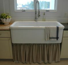 Love this apron style sink... Would change out the faucet, and insert in cabinet or possibly free standing??? Some more thought is in need.