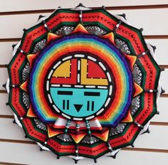 """29: Hopi Kachina Plaque, 20th century item. Made of wood, paint and yarn, this item measures 17"""" x 17"""" x 1"""". Hopi, northern-central Arizona. Large plaque with Kachina face and yarn design around it. Condition: Very good, see images. Shipping: $30.00."""