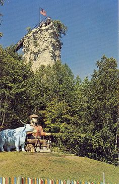 Paul Bunyan and his Blue Ox Babe in St Ignace Michigan at Castle Rock Lookout Ojibway Tribe Totem Poles on site as well