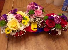 Floral arrangement in a kitchen utensil #measuringcups #floral #countryfair