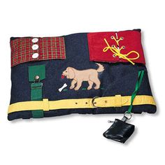 This activity mat for people with dementia is suitable for men. It features flannel pieces that button over patterned fabric, corduroy pieces that lace over a vinyl picture frame in which to place a favourite photo, an overall buckle, a belt with belt loops and buckle, animal appliqus, and simulated trouser pocket with zippered coin …