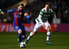 Lionel Messi of Barcelona (L) in action during the UEFA Champions League Group C match between Celtic FC and FC Barcelona at Celtic Park Stadium on November 23, 2016 in Glasgow, Scotland.